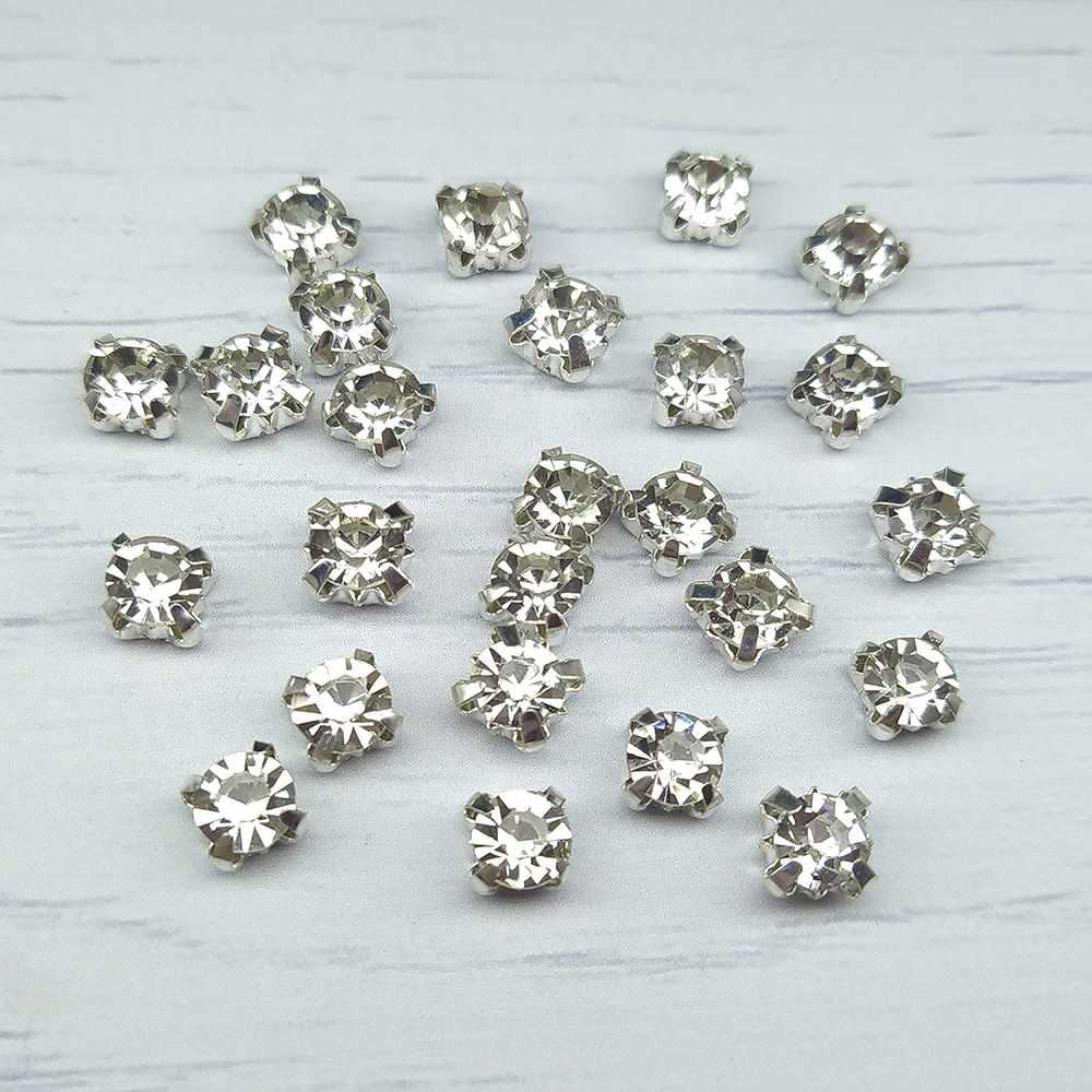 СЦ001НН66 Хрустальные стразы в металлических цапах (серебро) Белые 6 мм 24-25 шт./упак.