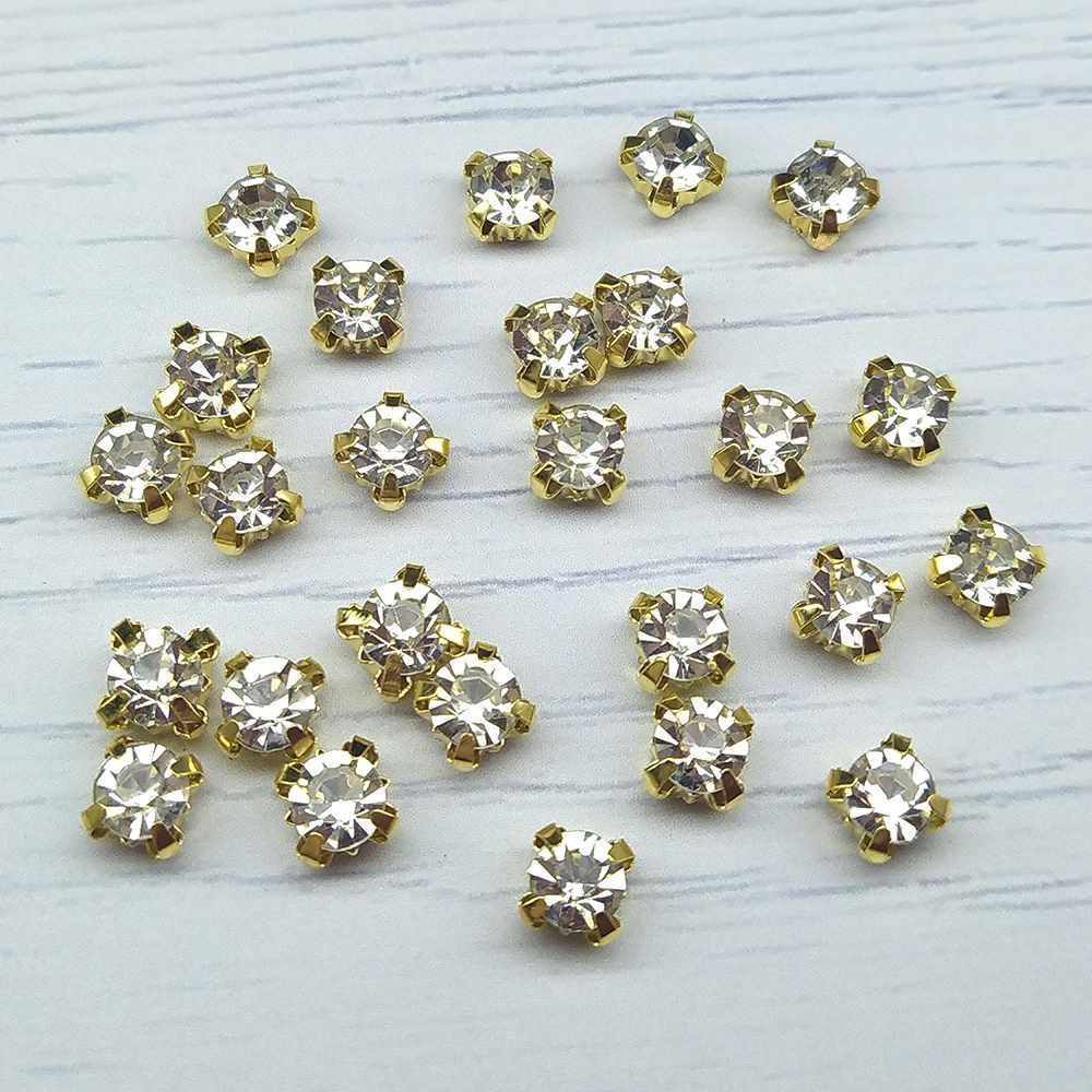 ЗЦ001НН66 Хрустальные стразы в металлических цапах (золото) Белые 6 мм 25 шт./упак.