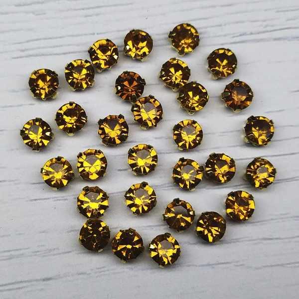 ЗЦ013НН66 Хрустальные стразы в металлических цапах (Золото) медовый